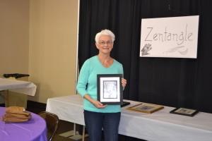 Linda Keller holds an example of her artwork, called Zentangle.