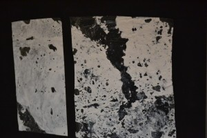 An example of Karen's process - paint transferred from  the plastic sheeting to the black background.
