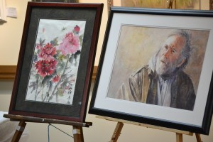 Two examples of Misuk's watercolors. She pointed out to the audience that not all her paintings are portraits.