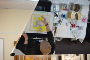 Sandy is starting her first pour on a painting on Tuesday evening. In her studio, she often works on several paintings simultaneously. The painting must be thoroughly dry before any subsequent pours.
