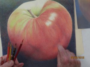 Tom applies colored pencil