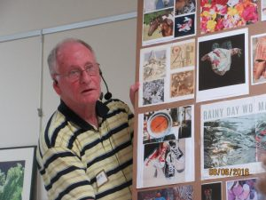 Tom shows books and magazines
